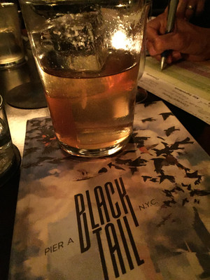 Cocktail and menu at Blacktail in New York City